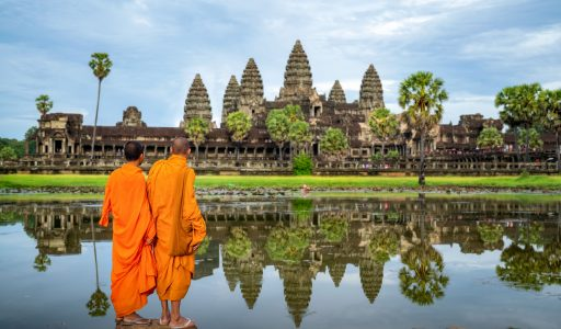 Asian  monk stand and look to Angkor wat in siem reap, Cambodie, this image can use for travel and landmaek in Asia