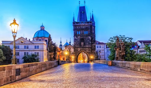 Charles bridge and Old Town of Prague in morning twilight.
